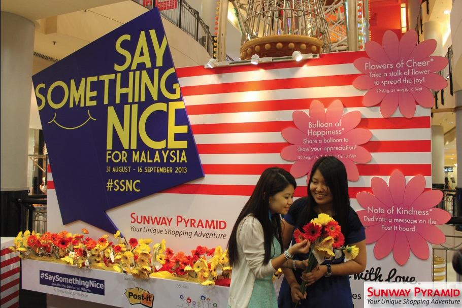 Shoppers receiving flowers during the launch of #SaySomethingNice Campaign